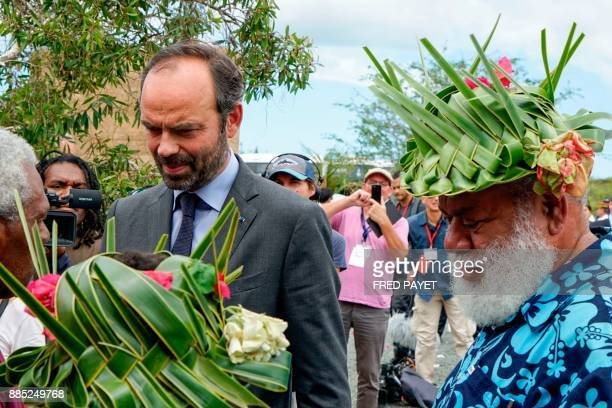French Prime Minister Edouard Philippe speaks with the president of the North Province of New Caledonia Paul Neaoutyine during a welcoming ceremony...
