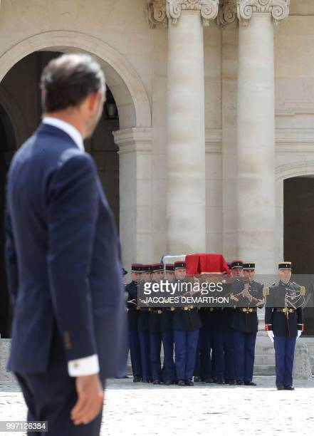 French Prime minister Edouard Philippe stands at the Invalides as French Republican Guards carry the coffin of French filmmaker and writer Claude...