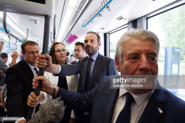 French Prime Minister Edouard Philippe stands in the tramway as he supports La Republique en marche party's candidates for the legislative elections...