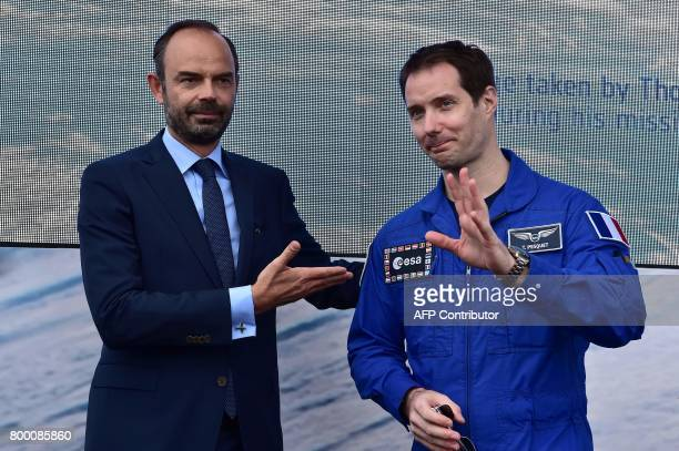 French Prime Minister Edouard Philippe stands with French astronaut Thomas Pesquet during a visit to the International Paris Air Show in Le Bourget...