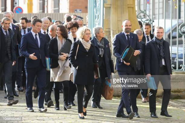 French Prime Minister Edouard Philippe surrounded by French Junior Minister for Public Administration Olivier Dussopt French Minister for the...