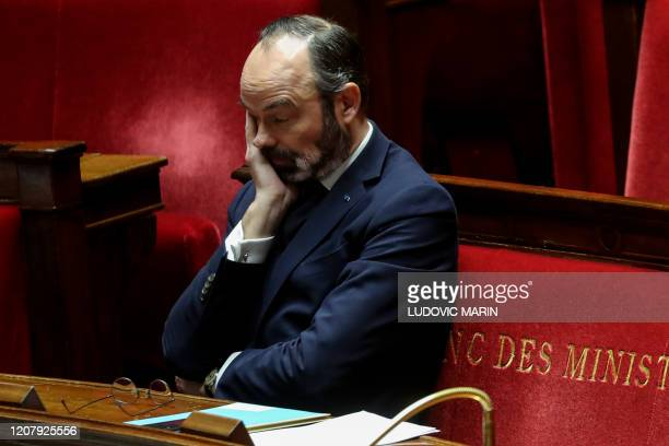 French Prime Minister Edouard Philippe takes part in a debate about the state of health emergency bill at the National Assembly on March 21 in Paris...
