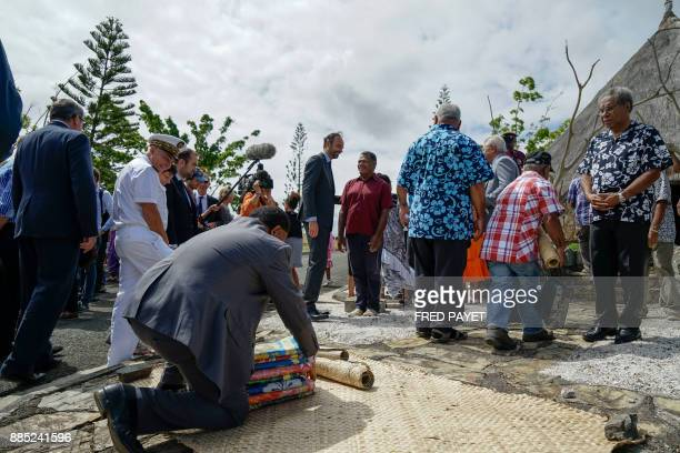 French Prime Minister Edouard Philippe takes part in a welcoming ceremony as he arrives to visit Kone a city in Grande Terre island on December 4...
