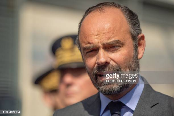 French Prime Minister Edouard Philippe talks to the press as he visits the district of Kalliste in Marseille southern France on April 12 2019