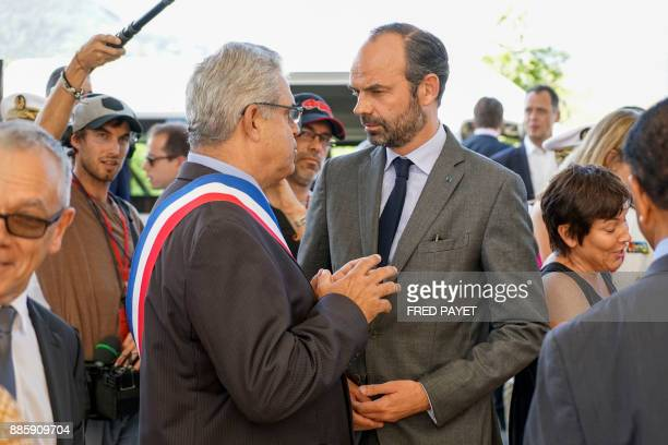 French Prime Minister Edouard Philippe talks with MontDore mayor Eric Gay during the inauguration of a high school on December 5 2017 in MontDore /...