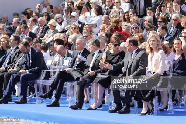 French Prime Minister Edouard Philippe the President of the French National Assembly Francois de Rugy former French President Nicolas Sarkozy his...