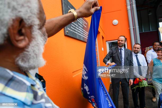 French Prime Minister Edouard Philippe unveils the inaugurative plaque during the inauguration ceremony of the KonePouembout rescue centre in Kone a...