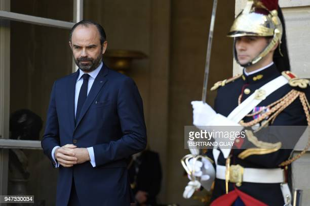 French Prime Minister Edouard Philippe waits for the arrival of Canadian Prime Minister at the Hotel de Matignon, on April 17, 2018 in Paris. / AFP...