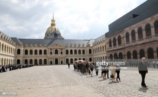 French Prime minister Edouard Philippe walks behind people at the Invalides during a tribute ceremony to French filmmaker and writer Claude Lanzmann...