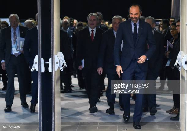 French Prime Minister Edouard Philippe walks in a corridor during the National Conference of Territories at the Grand Cahors exhibition centre in...