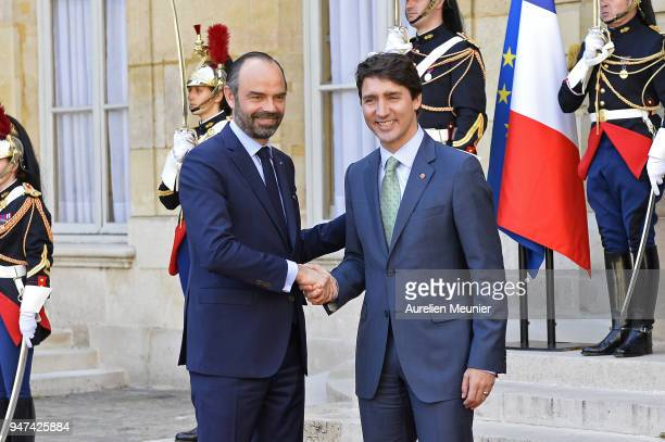 French Prime Minister Edouard Philippe welcomes Canadian Prime Minister Justin Trudeau for a meeting at Hotel de Matignon on April 17 2018 in Paris...