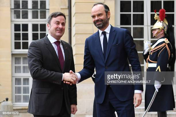 French Prime Minister Edouard Philippe welcomes Luxembourg Prime Minister Xavier Bettel upon his arrival at the Hotel de Matignon prior to a...