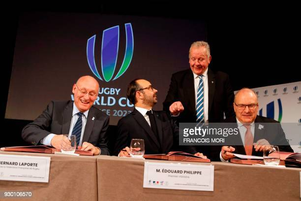 French Prime Minister Edouard Philippe World Rugby Chairman Bill Beaumont standing French Rugby Federation President Bernard Laporte general...
