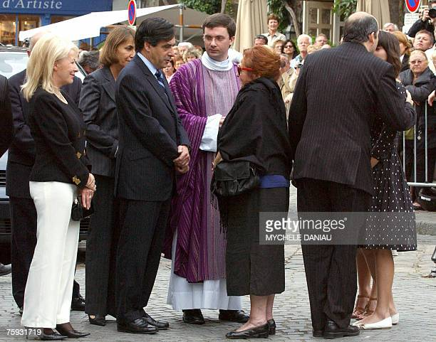 French Prime Minister Francois Fillon and Culture Minister Christine Albanel flanked by former Minister Nicole Hameline comfort Nita French actor...
