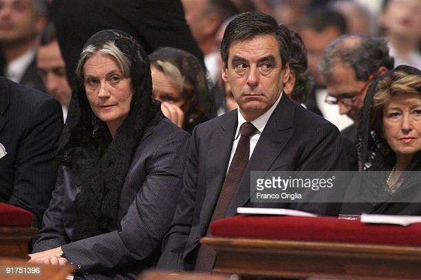 French Prime Minister Francois Fillon and his wife Penelope attend a canonisation ceremony held by Pope Benedict XVI at St Peter's Basilica on...