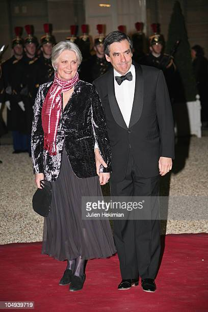 French Prime Minister Francois Fillon arrives with wife Penelope to attend a state dinner honouring visiting Russian President Dmitry Medvedev at...