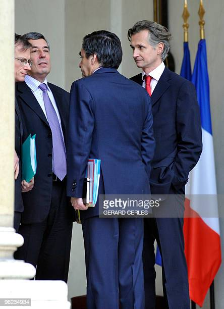 French Prime Minister Francois Fillon chats with French President Nicolas Sarkozy's special advisor Henry Guaino and staff members at the end of a...