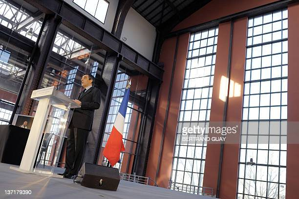 French Prime minister Francois Fillon delivers a speech as he visits the project of the Cité du Cinéma on January 16 2012 in SaintDenis outside Paris...