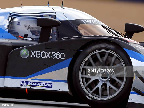 French Prime Minister Francois Fillon drives the Peugeot 908 HDI FAP N° 9 the winning car of the 2009 edition of Le Mans' 24 Hours race on November 8...