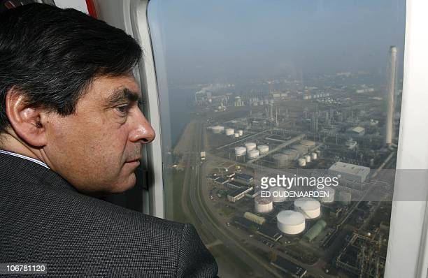 French Prime Minister Francois Fillon flies over the Rotterdam harbor with Dutch Prime Minister Jan Peter Balkenende 15 October 2007 Fillon is on a...