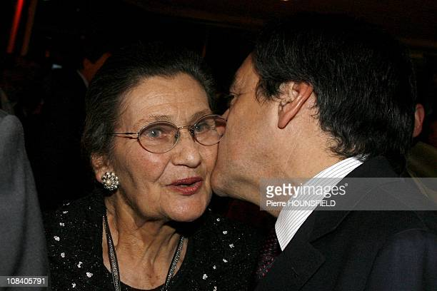 French Prime minister Francois Fillon is kissing Simone Veil in Paris France on March 02nd 2009