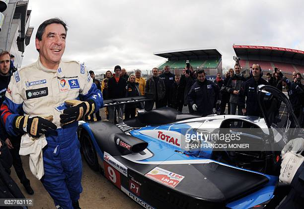French Prime Minister Francois Fillon is pictured after driving the Peugeot 908 HDI FAP N° 9 the winning car of the 2009 edition of Le Mans' 24 Hours...
