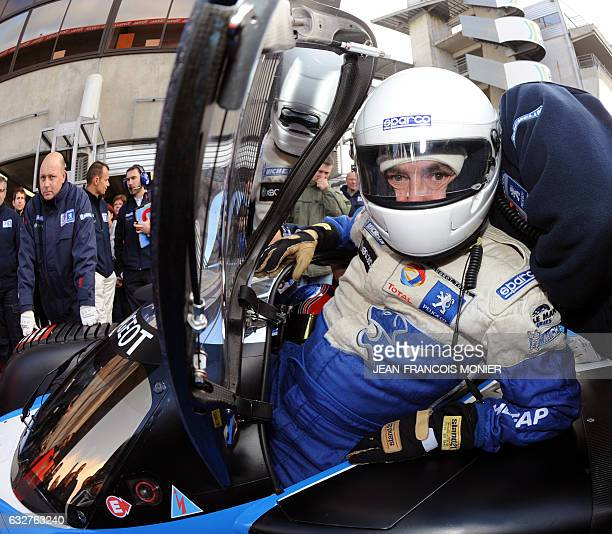 French Prime Minister Francois Fillon is pictured before driving the Peugeot 908 HDI FAP N° 9 the winning car of the 2009 edition of Le Mans' 24...