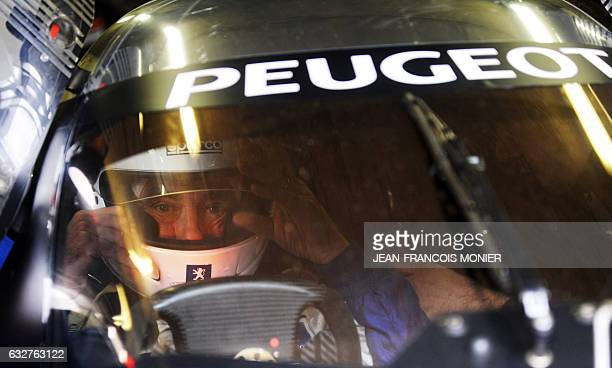 French Prime Minister Francois Fillon prepares to drive the Peugeot 908 HDI FAP N° 9 the winning car of the 2009 edition of Le Mans' 24 Hours race on...