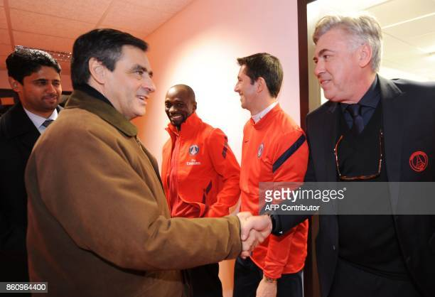 French Prime Minister Francois Fillon shakes hands Paris SaintGermains Italian Head coach Carlo Ancelotti as Paris SaintGermains Qatar President and...