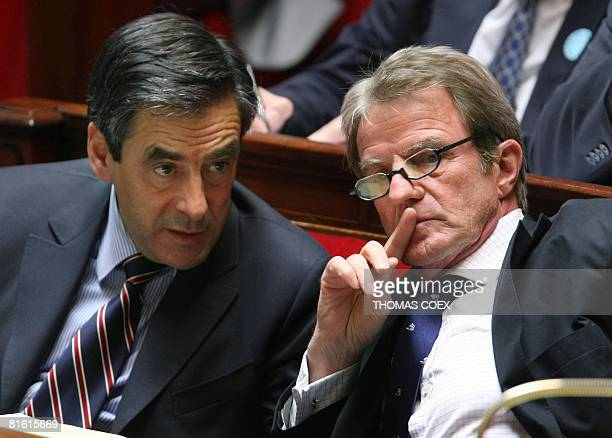 French Prime Minister Francois Fillon speaks with French Foreign Affairs Minister Bernard Kouchner at the French National Assembly on June 18 2008 in...