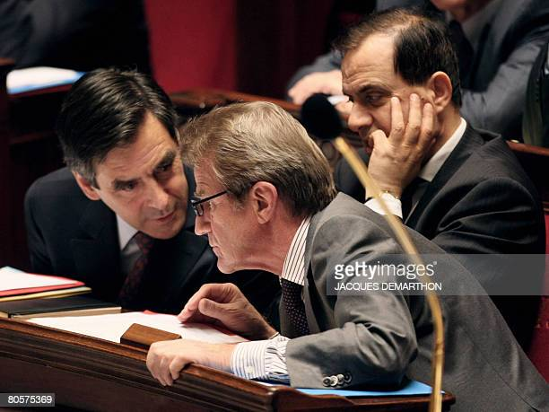 French Prime minister Francois Fillon speaks with listens Minister of Foreign and European Affairs Bernard Kouchner as Minister of State attached to...