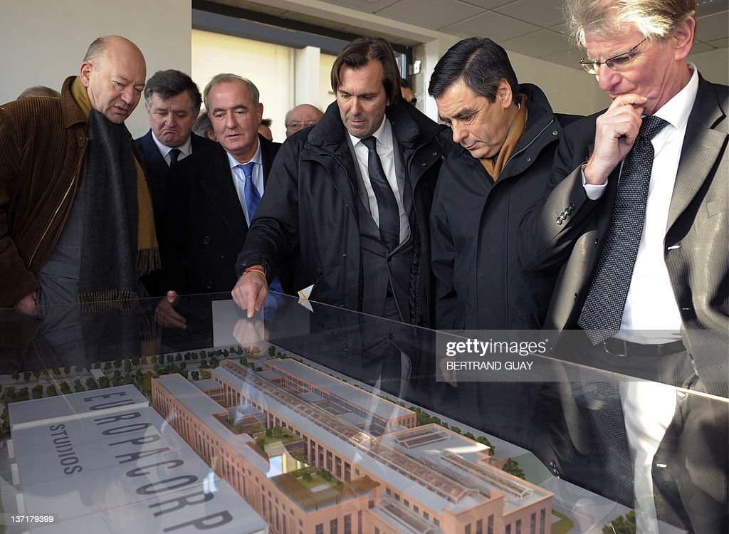 French Prime minister Francois Fillon (2ndR) visits the project of the 'Cité du Cinéma' (City of the Cinema) with Seine-Saint-Denis deputy Patrick Braouzec (R), publicist Christophe Lambert (C) and Urban Development Minister Maurice Leroy (3rdL) as part of the 'Grand Paris' (the'Greater Paris') project on January 16, 2012 in Saint-Denis, outside Paris. The French National Assembly on December 1, 2009 passed a bill setting in motion a master plan to create a 'Greater Paris' with a new 40-station metro line connecting the capital to its gritty suburbs. The legislation outlining the 21-billion-euro (32-billion-dollar) infrastructure project was adopted by a vote of 299 to 216 and is due to go before the Senate for final approval in February.