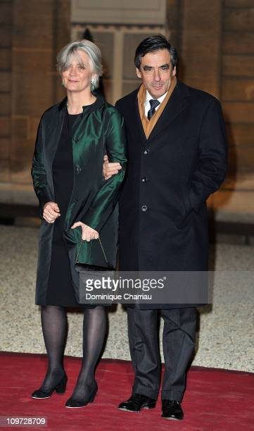 French Prime minister François Fillon and his wife Penelope pose as they arrive to the State Dinner At Elysee Palace Honouring South African...