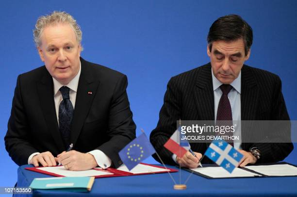 French Prime minister François Fillon and Quebec's counterpart Jean Charest sign agreements on November 26 2010 at the Hotel Matignon the Premier�s...