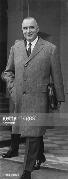French Prime Minister Georges Pompidou leaves the Élysée Palace in Paris after a cabinet meeting at which the Common Market was the main topic of...