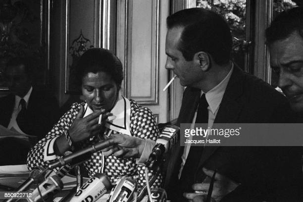 French Prime Minister Jacques Chirac and Health Minister Simone Veil smoking during a press conference
