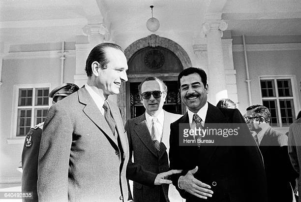 French Prime Minister, Jacques Chirac and President Saddam Hussein after signing an agreement giving priority to France for commercial exchange with...