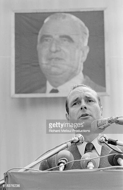French Prime Minister Jacques Chirac dedicates the Avenue Georges Pompidou in RueilMalmaison Behind him hangs a portrait of Georges Pompidou who...