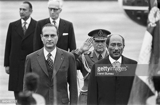 French Prime Minister Jacques Chirac escorts Egyptian President Anwar El Sadat to the airport after a two and halfday official visit