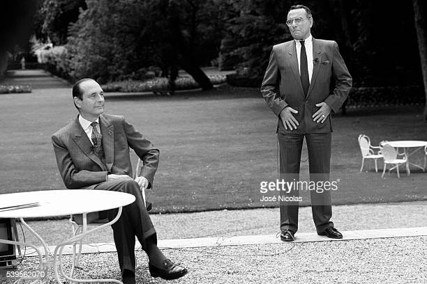 French Prime Minister Jacques Chirac receives TV journalist Yves Mourousi in the gardens of the Elysee Palace