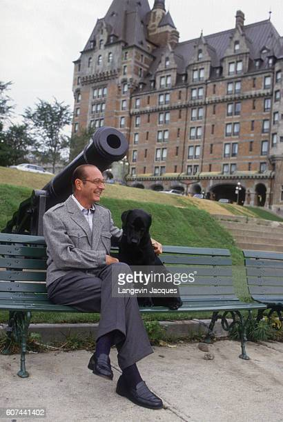 French Prime Minister Jacques Chirac sits with his threemonthold labrador named Maskou originally from Quebec on the grounds of the Hotel Chateau...