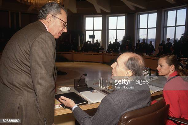 French Prime Minister Jacques Chirac talks with President Francois Mitterrand and Secretary of State Elisabeth Guigou during the second day of the...