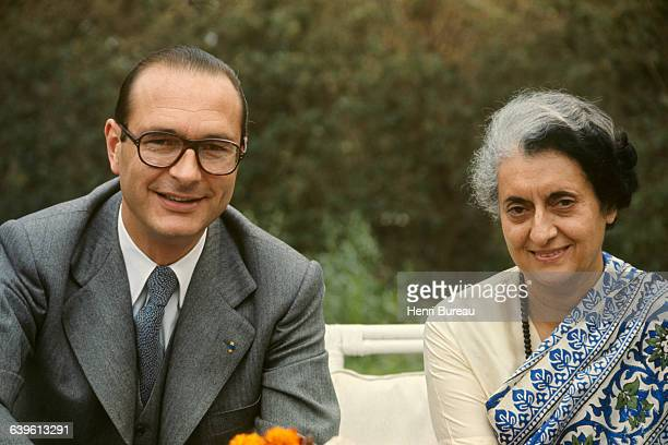 French Prime Minister Jacques Chirac with wife Bernadette are welcomed by Indian Prime Minister Indira Gandhi in the garden of the Fench embassy in...