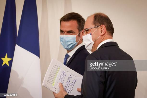 French Prime Minister Jean Castex and French Health Minister Olivier Veran reacts as they leave at the end of a press conference, at the Hotel...