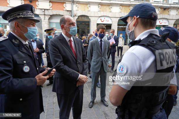 French Prime Minister Jean Castex and government spokeman Gabriel Attal talks to policemen in the streets as part of a visit to Lille on August 03...