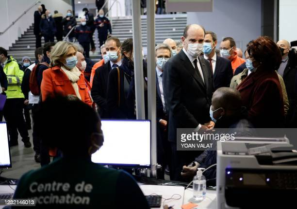 French Prime Minister Jean Castex and Paris' region president Valerie Pecresse visit the Covid-19 vaccination center setup inside the Stade de France...