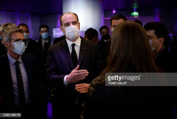 French Prime Minister Jean Castex arrives with others officials and elected for a visit of the Covid-19 vaccination center setup inside the Stade de...