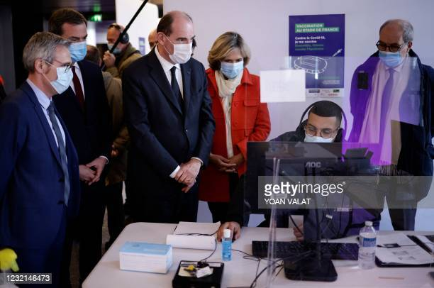 French Prime Minister Jean Castex , French Health Minister Olivier Veran and Paris' region president Valerie Pecresse visit the Covid-19 vaccination...