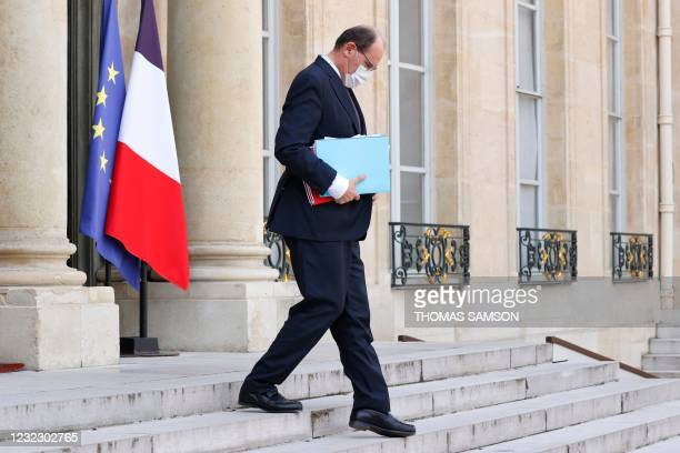 French Prime Minister Jean Castex leaves after taking part in the weekly cabinet meeting at The Elysee Presidential Palace in Paris on April 14, 2021.