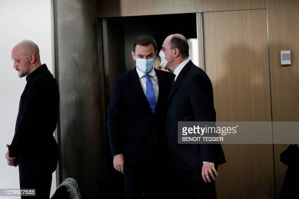French Prime Minister Jean Castex speaks with French Health Minister Olivier Veran ahead of a press conference to outline France's strategy for the...
